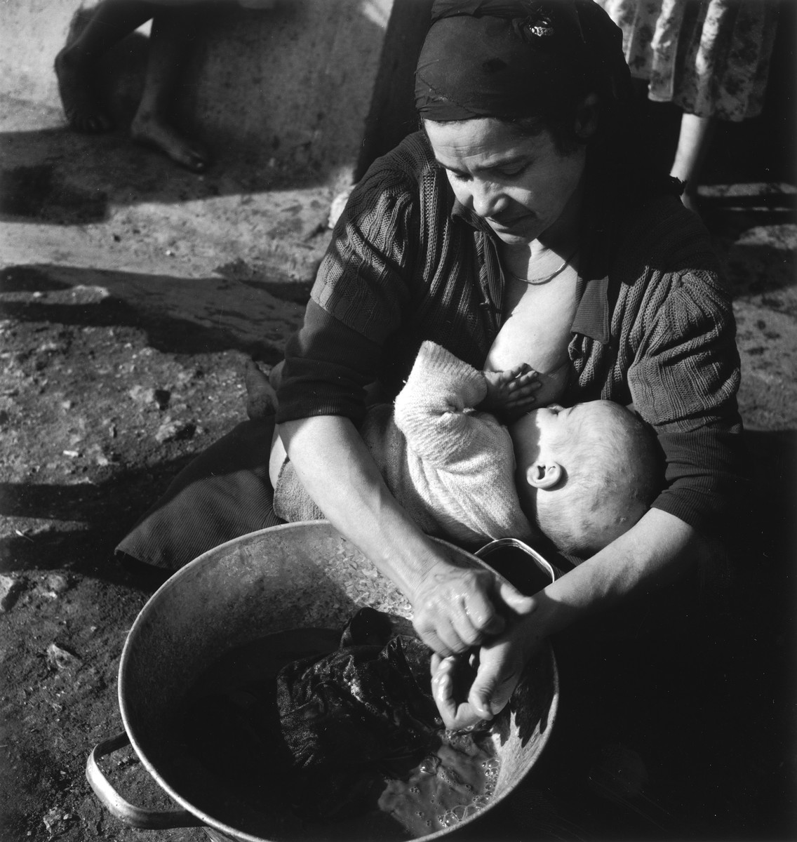 A young Morrocan-Jewish mother nurses her infant in the Los Arenas camp while waiting to immigrate to Palestine.