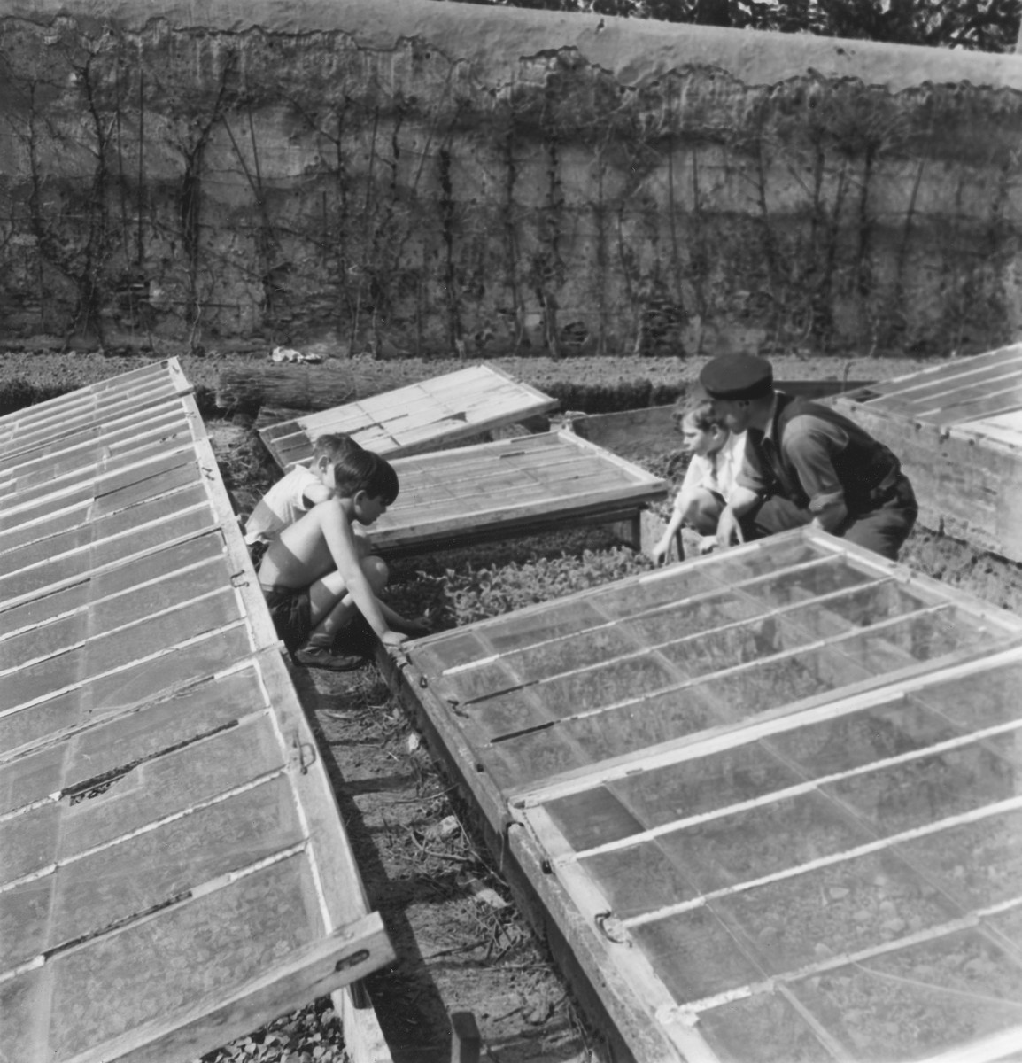 Children work in the gardens of La Forge, an OSE children's home in Fontenay-aux-Roses.