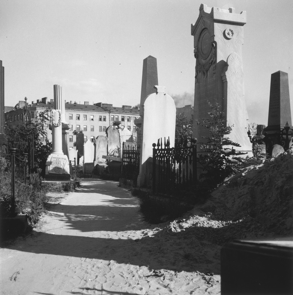 "The Jewish cemetery in the Warsaw ghetto.  Joest's original caption reads: ""Then the grave was covered over with earth.  Alongside were the graves of rich families, their well-kept tombstones engraved with Hebrew and Latin lettering, describing the dead."""