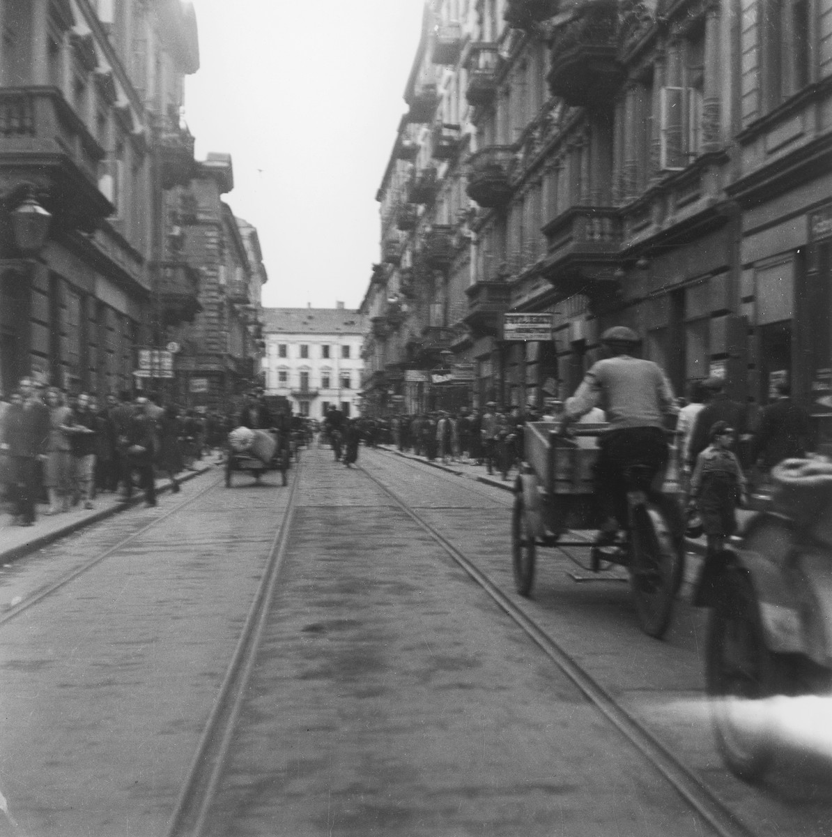 "View of Karmelicka street in the Warsaw ghetto.  Joest's original caption reads: ""This street was called Karmelicka.  It was full of these rickshaw drivers."""