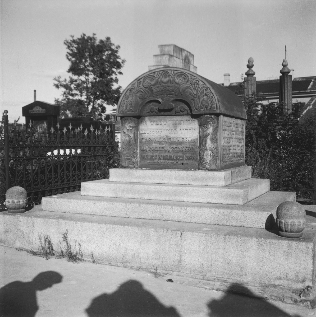 "A tombstone in the Warsaw ghetto cemetery.  Joest's original caption reads: ""Nearby stood this beautiful funerary monument with a psalm from the Book of Moses."""