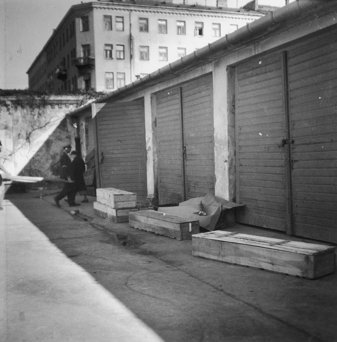 """View of wooden coffins used for burial in the Warsaw ghetto cemetery.  Joest's original caption reads: """"Only the better sort of the dead had boxes; the others..."""""""