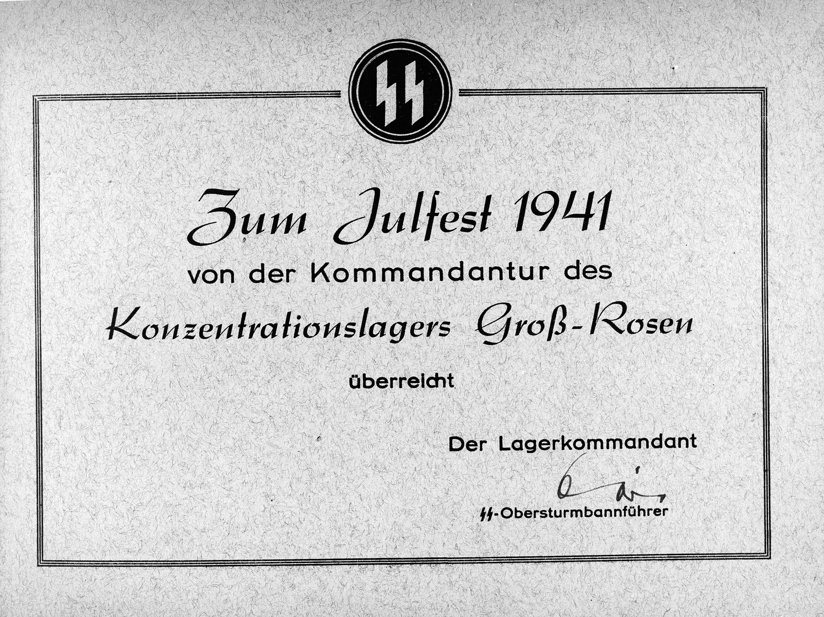 """A view of the cover to a photo album of the Gross-Rosen concentration camp, celebrating Julfest (Christmas).  The album covers events in the camp that occurred in 1941 , that reads the following in German: """"Zum Julfest 1941 von der Kommandantur des Konzentrationslagers Gross-Rosen."""""""