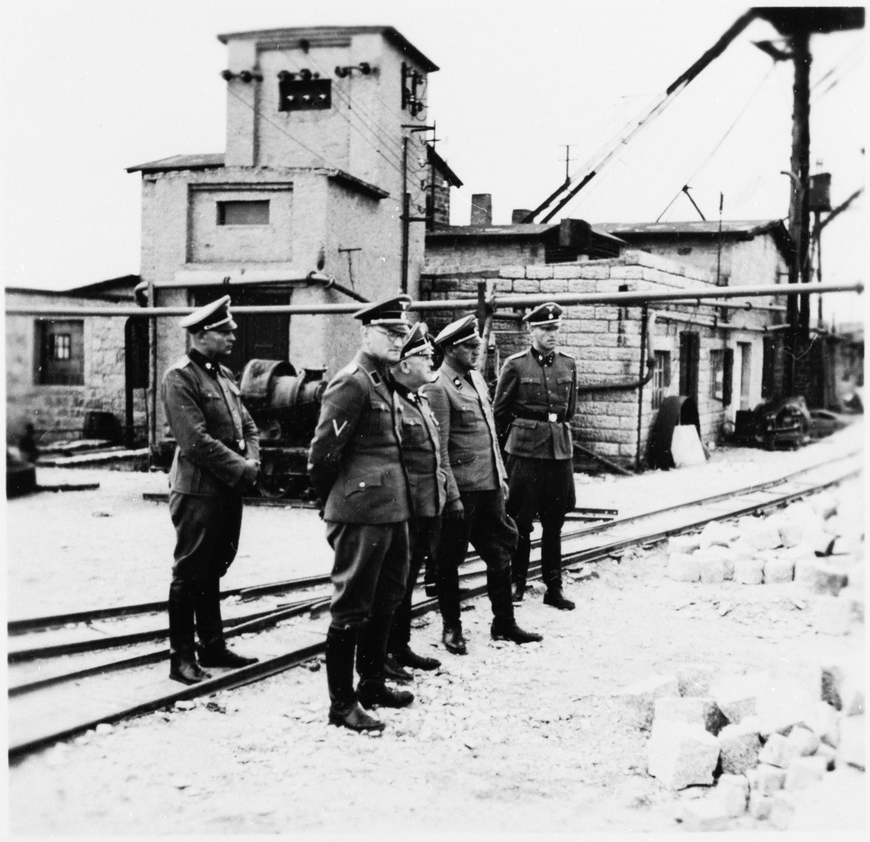 SS-Obergruppenfuehrer Ernst Schmauser visits the Gross-Rosen concentration camp's quarry with other SS officers.  Commandant Arthur Roedl is standing next to Schmauser in the center.