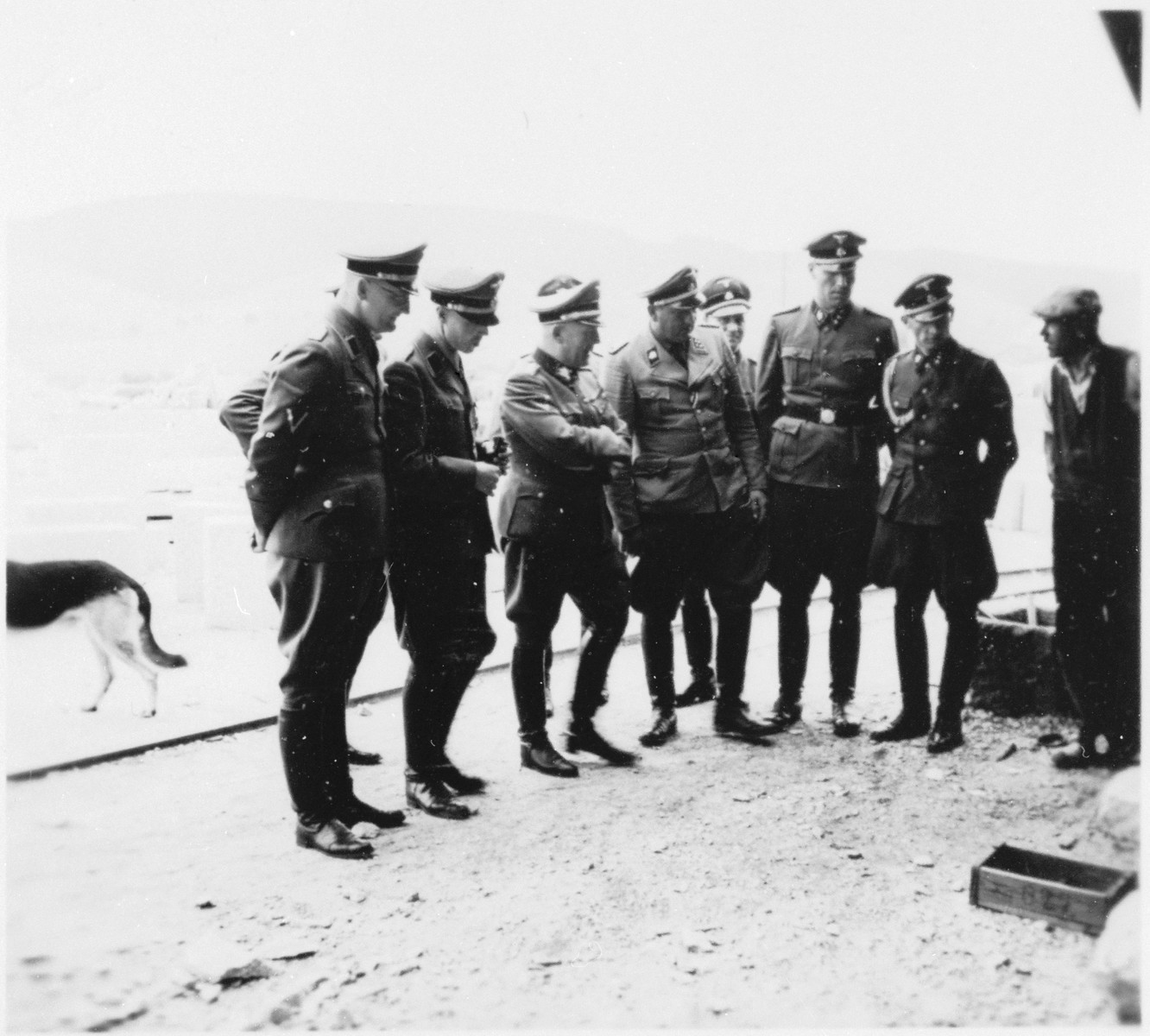SS Obergruppenführer Ernst Schmauser inspects the Gross-Rosen concentration camp in the company of other SS officers.  Schmauser is pictured third from the left.  Arthur Roedl is next to him in the center.  Roedl's adjutant, Kuno Schramm is the officer on the far right.