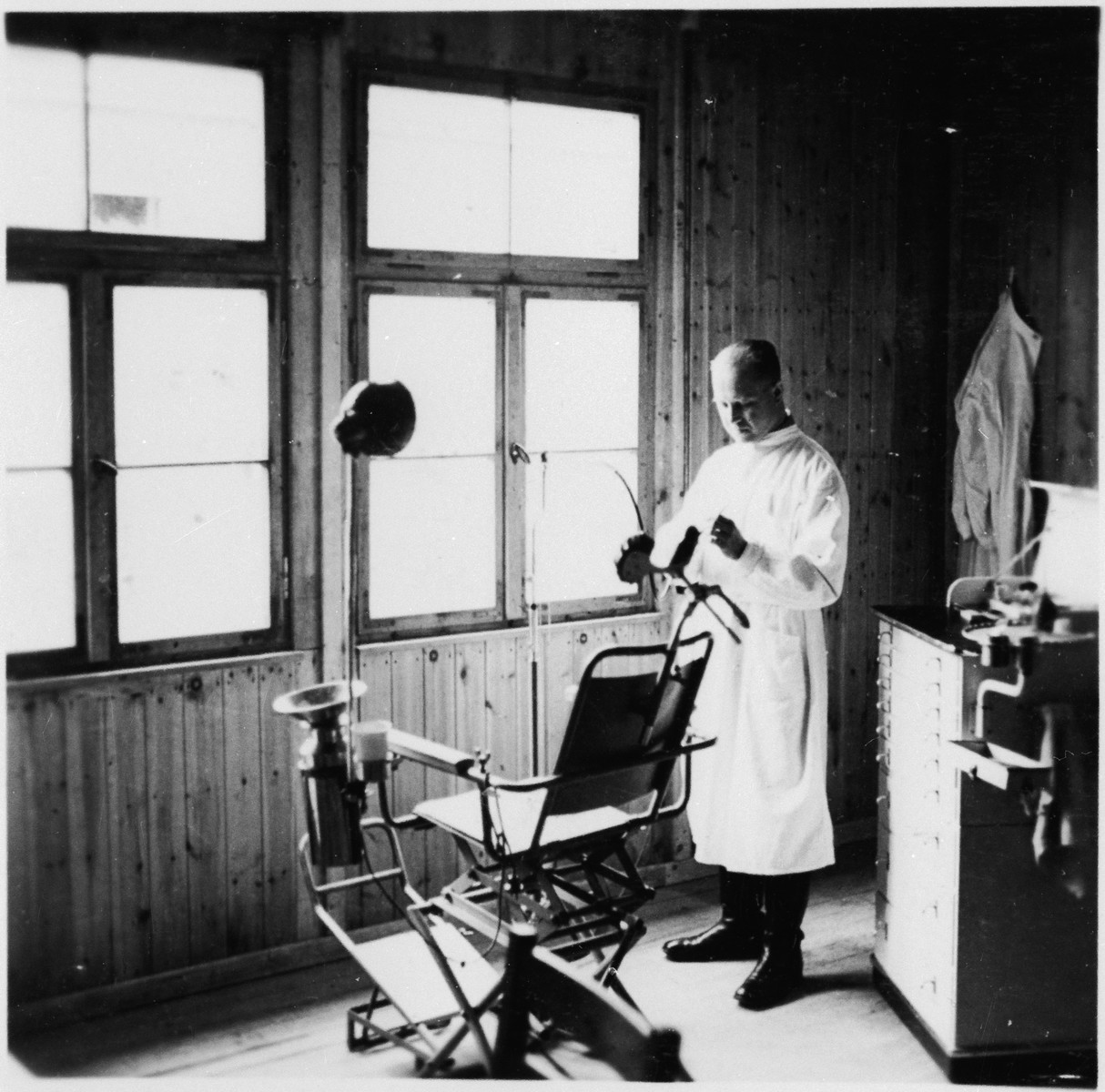 A dentist stands in his office on the grounds of the Gross-Rosen concentration camp.  Pictured is probably Dr. Eugen Krunick.