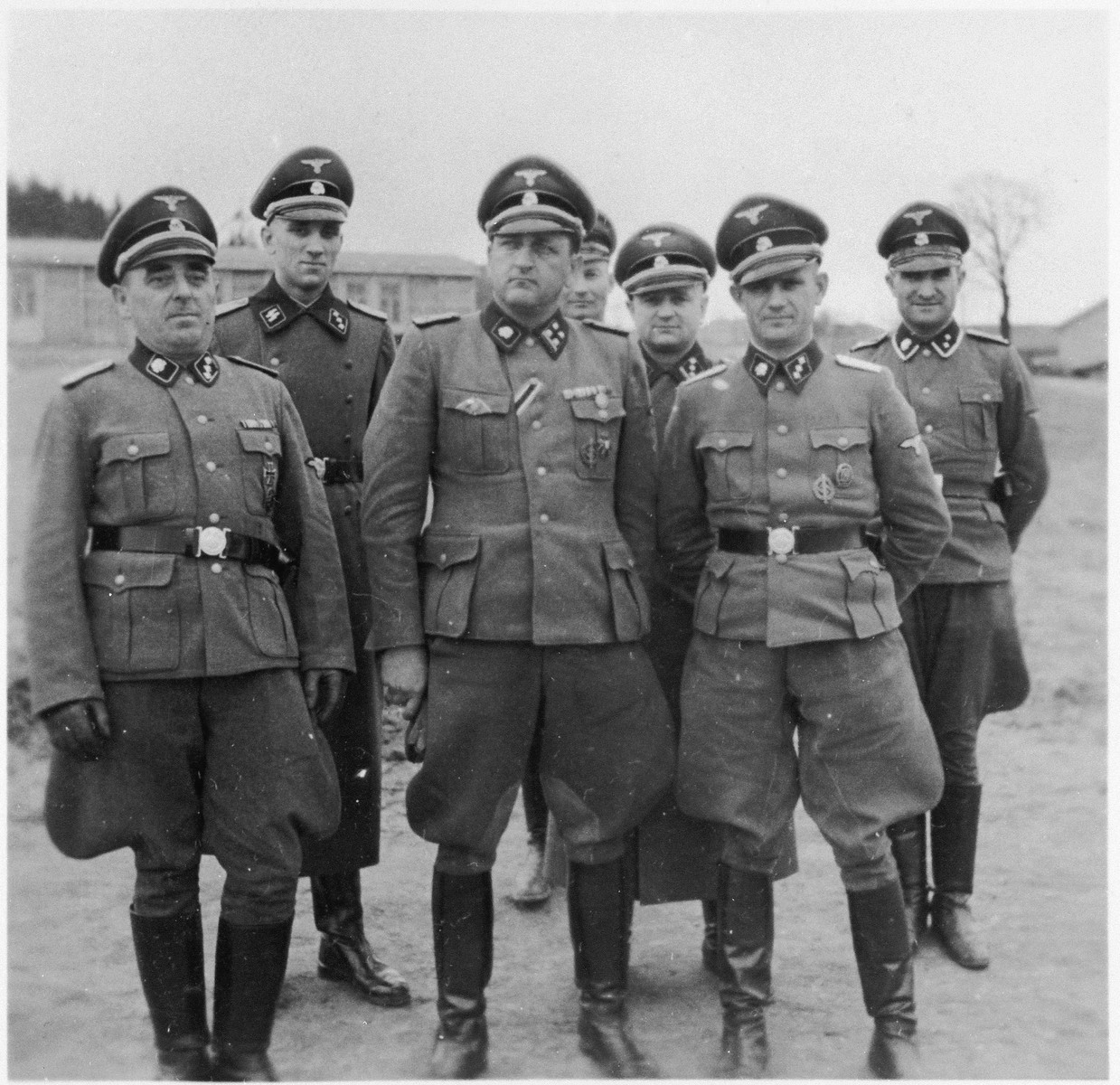 Group portrait of SS officers at the Gross Rosen concentration camp.  The commandant Arthur Roedl is in the center.  Scond from the left is probably Dr. Friedrich Entress.  SS-Ostuf Anton Thumann is in the first row, right.