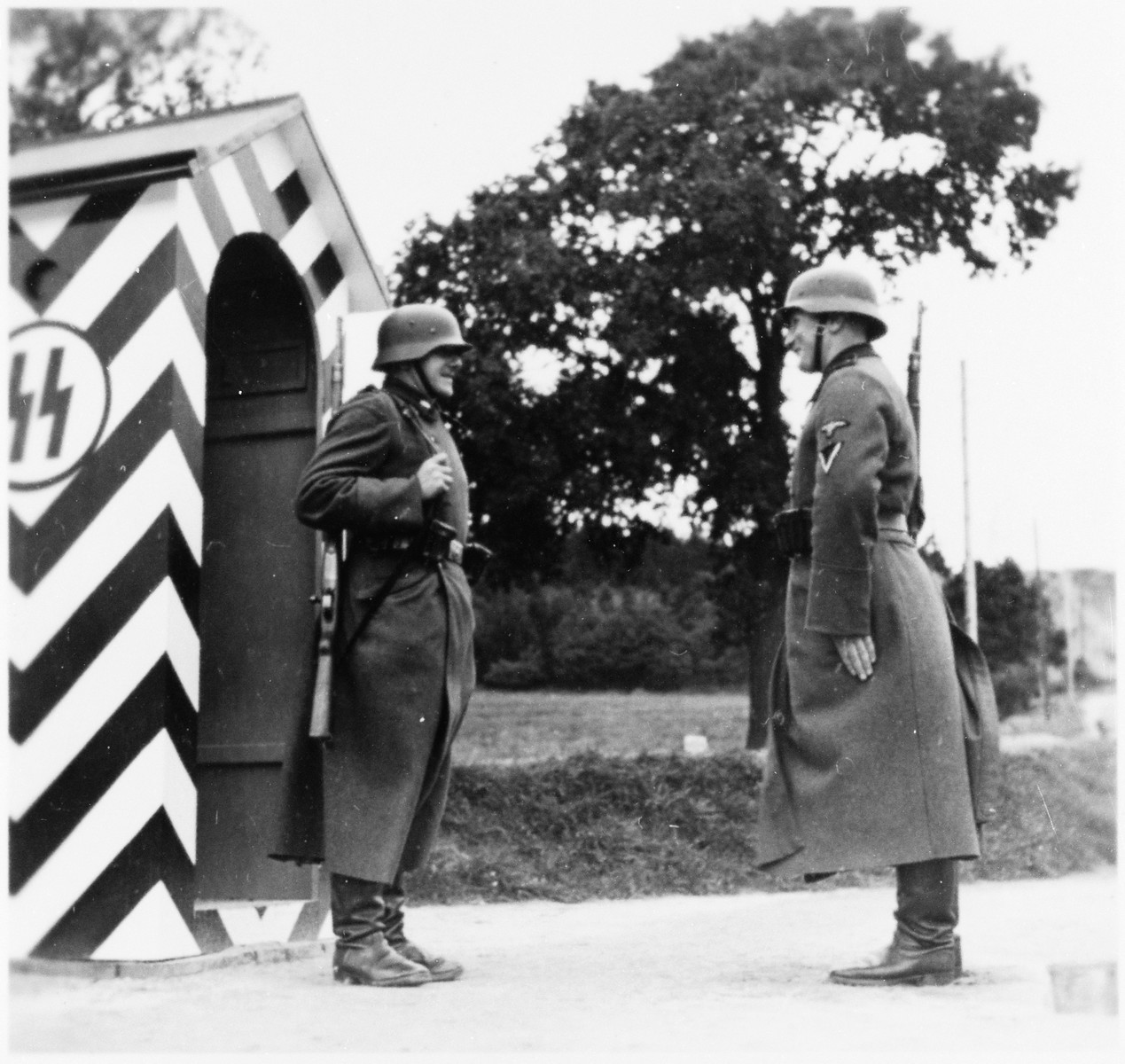 Guards stand at attention at a checkpoint at the Gross-Rosen concentration camp.