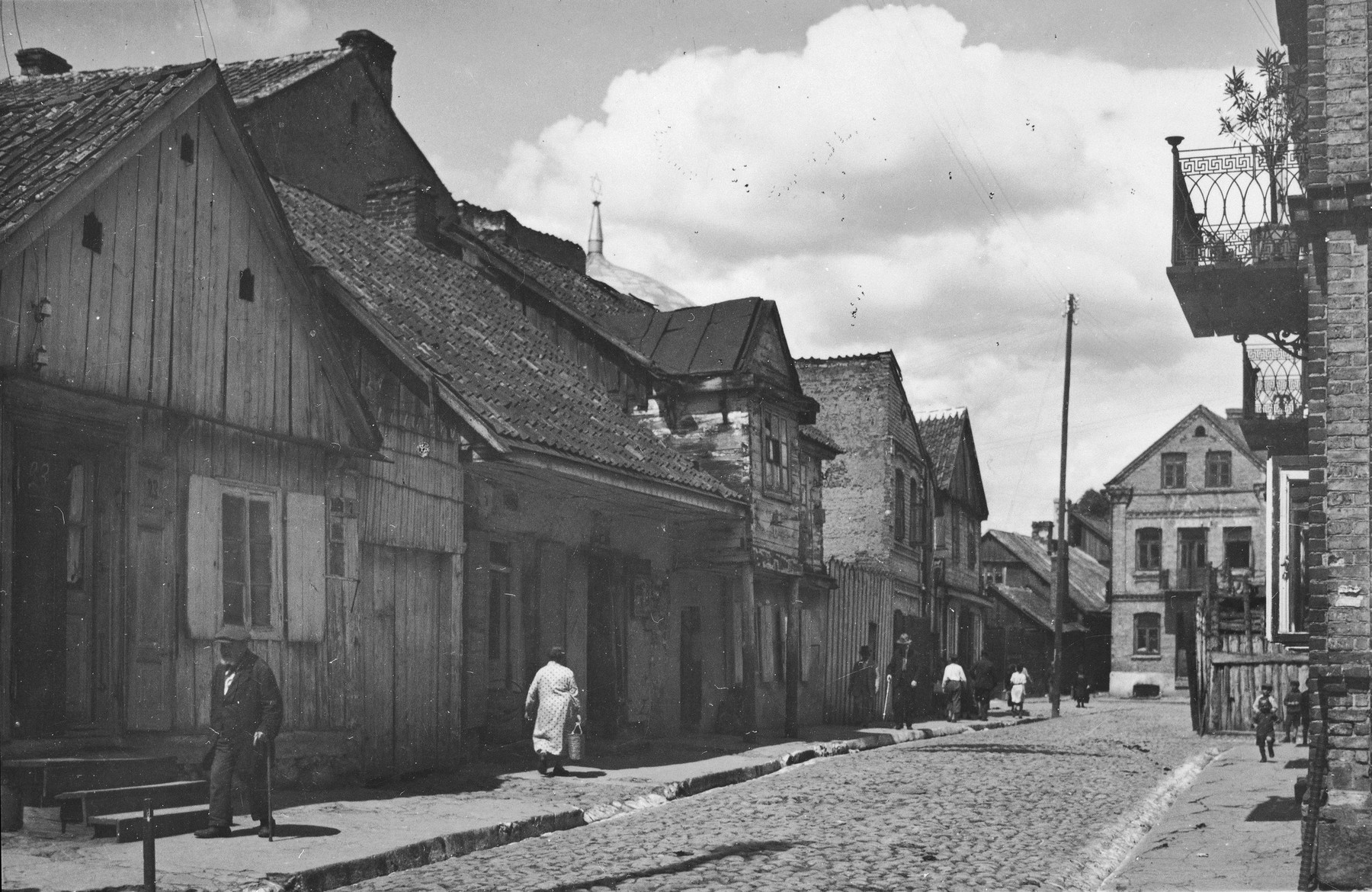 View of a street with wooden houses in prewar Bialystok.
