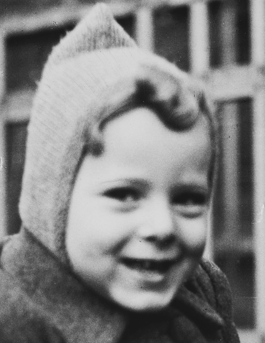 Close-up portrait of  a young Belgan-Jewish child,  prior to his going into hiding.  Pictured is Jean Iarchy [donor].