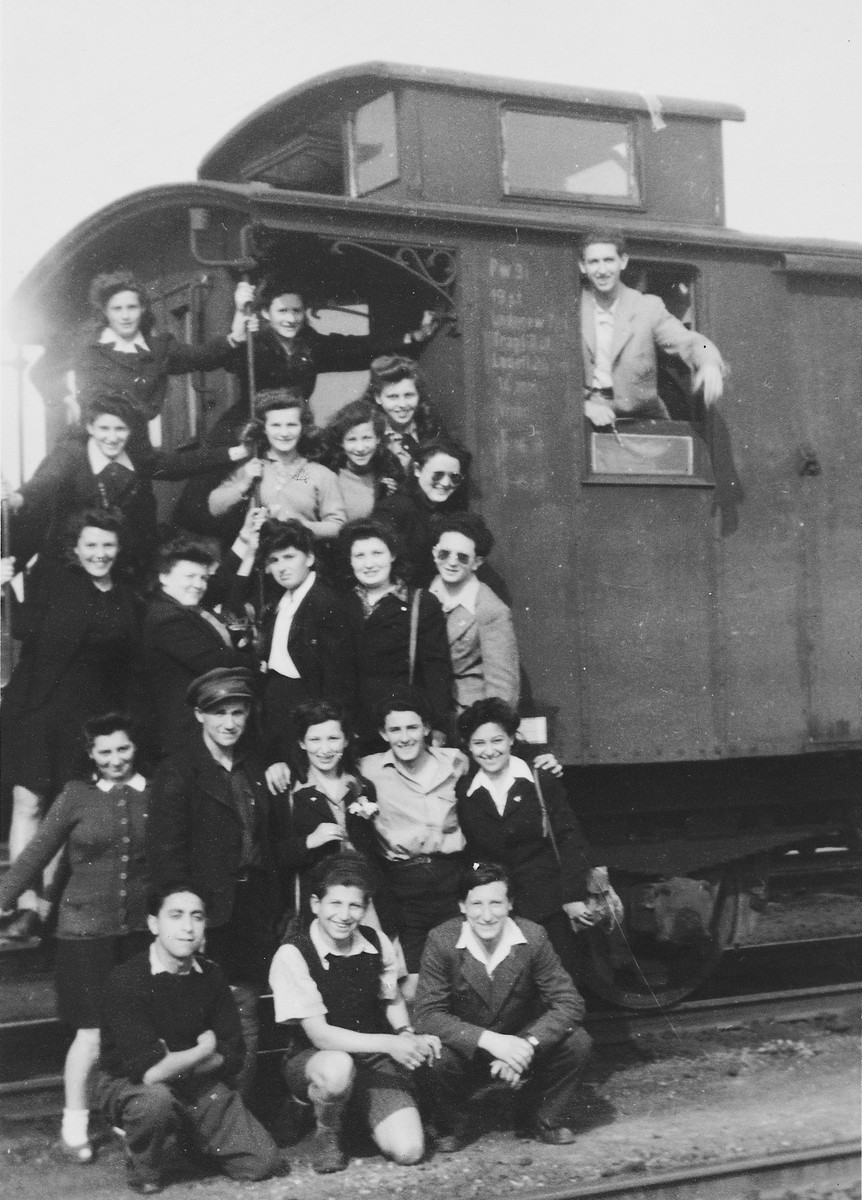 A group of Jewish youth from the Bergen-Belsen DP camp board a train for the coast on the first leg of their journey to Palestine.