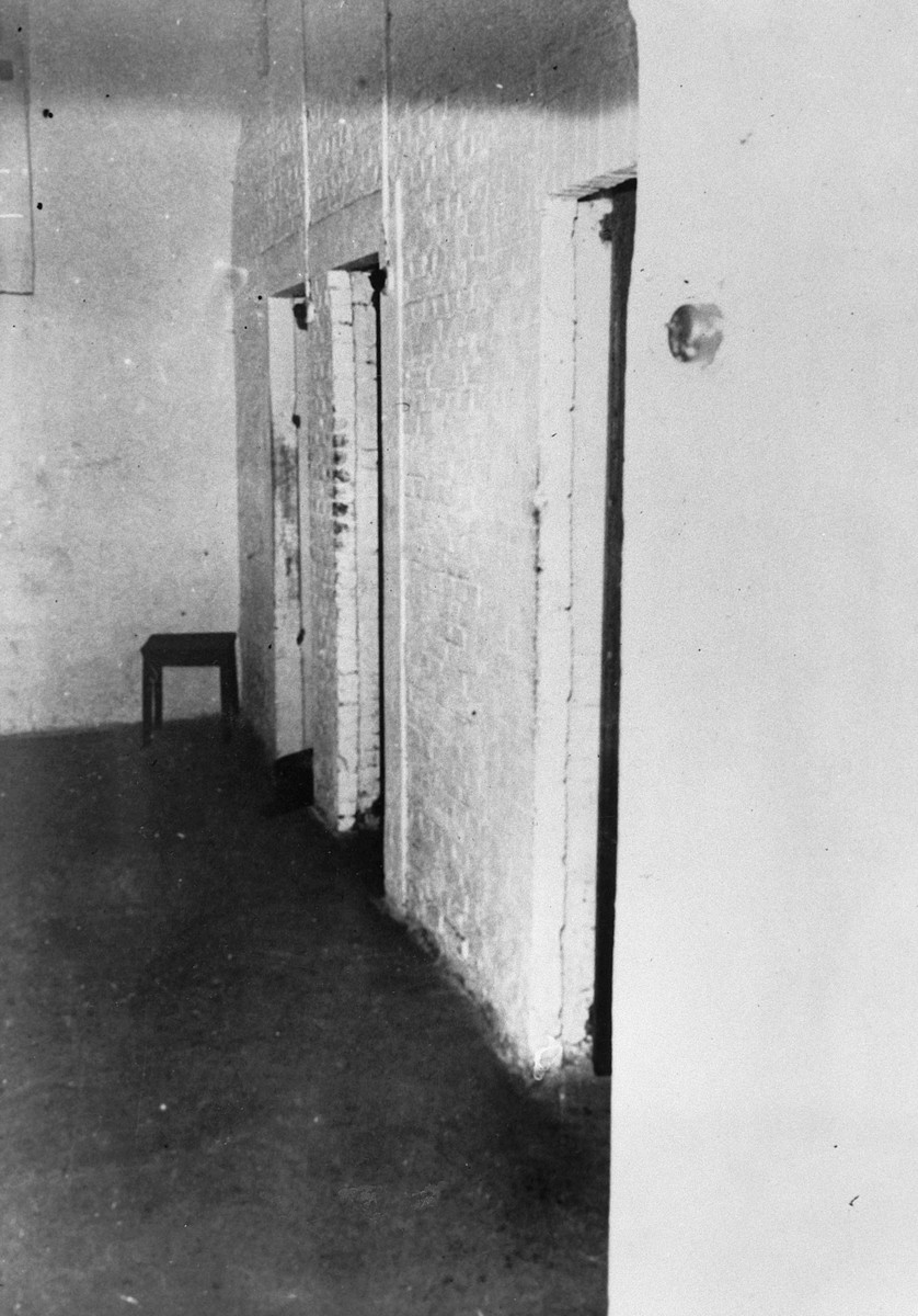 View of a whitewashed isolation cell in the Breendonck concentration camp.  Prisoners were not allowed to lean on the walls; if any whitewash appeared on their uniforms they were punished.