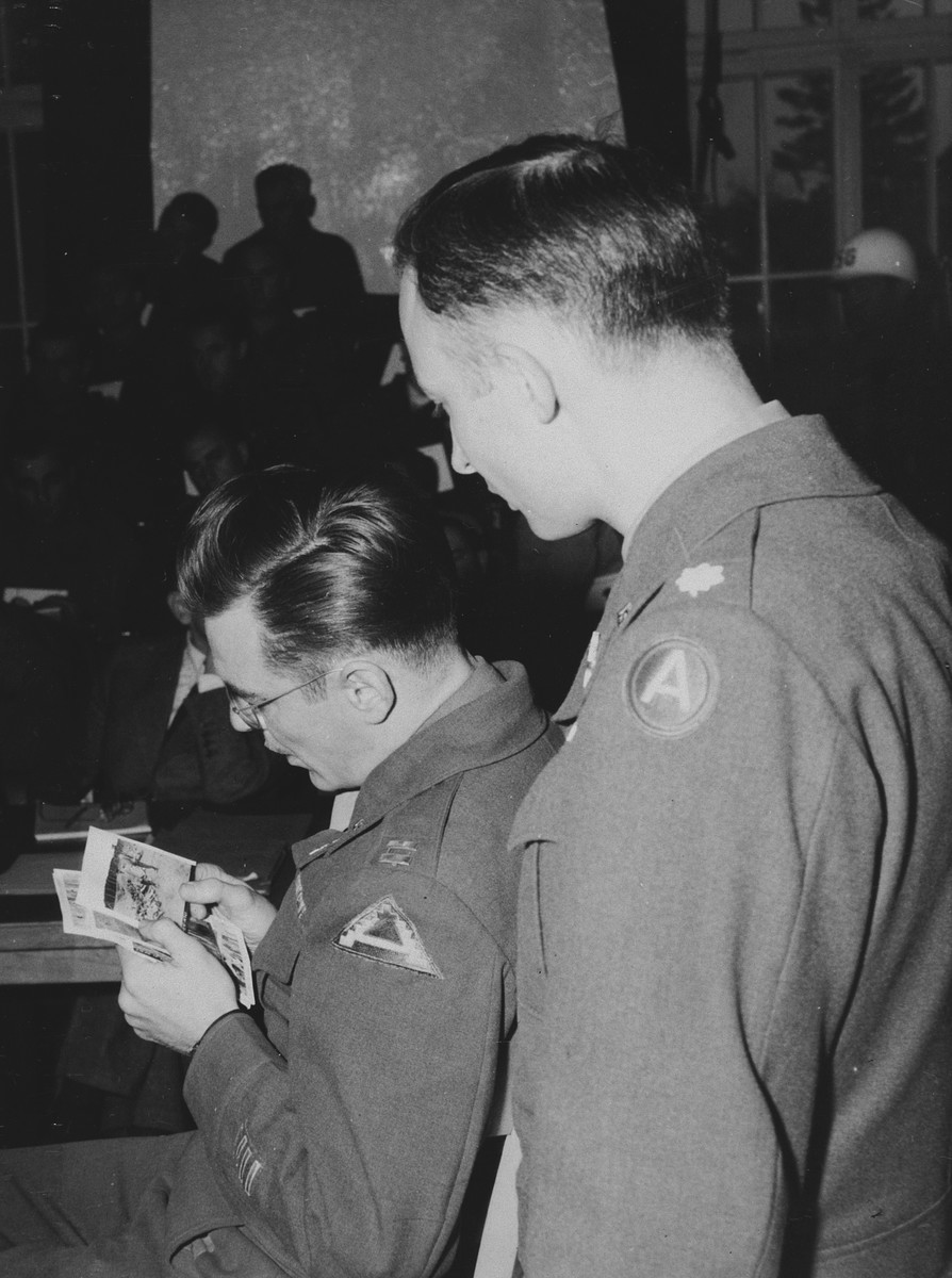 Capt. John Barnett authenticates photos taken when his troops overran the Dachau concentration camp during the trial of former Dachau camp personnel and prisoners.