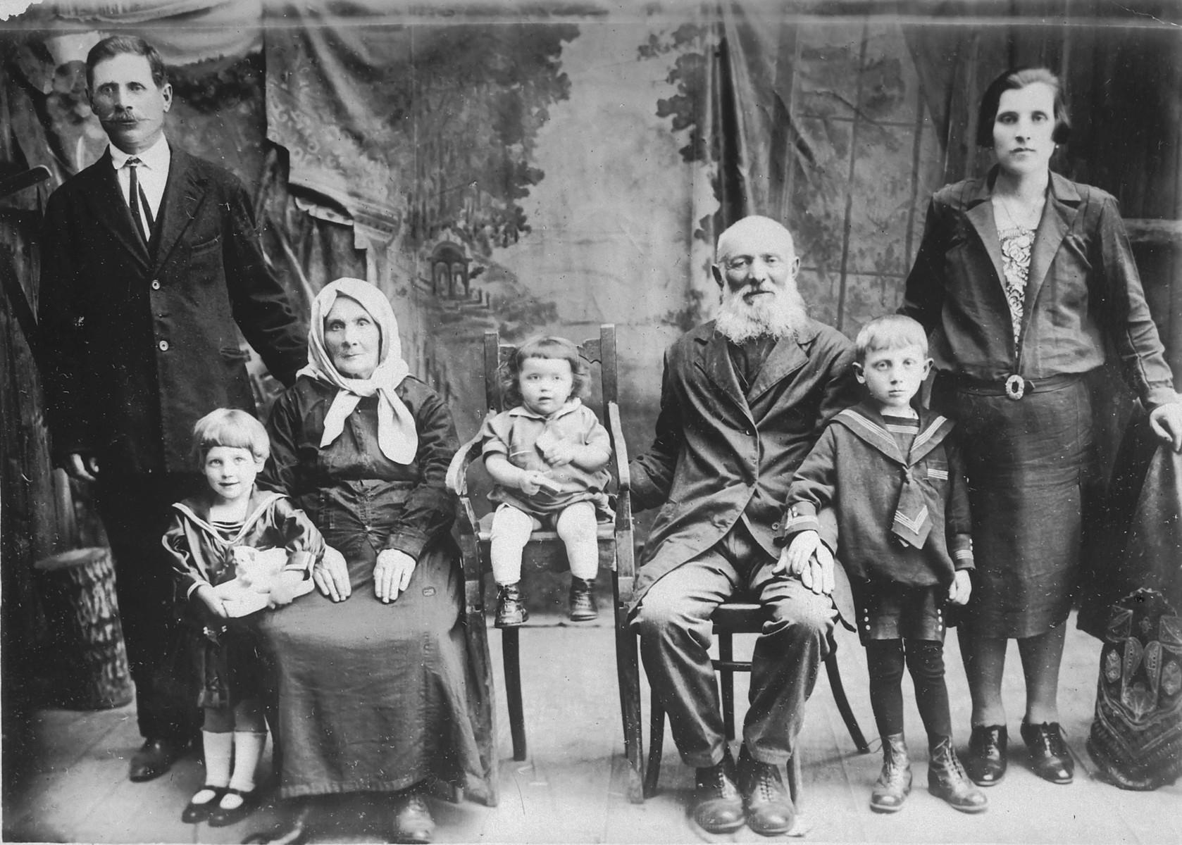 Studio portrait of the Becker and Rosenberg families in Hotin, Bessarabia.