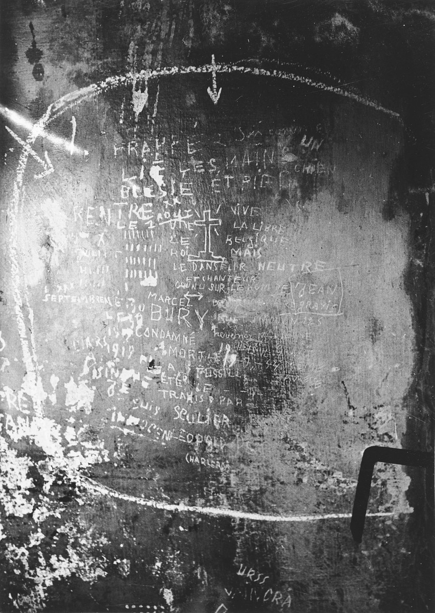 View of prisoner graffiti scratched on the walls of the Breendonck concentration camp.
