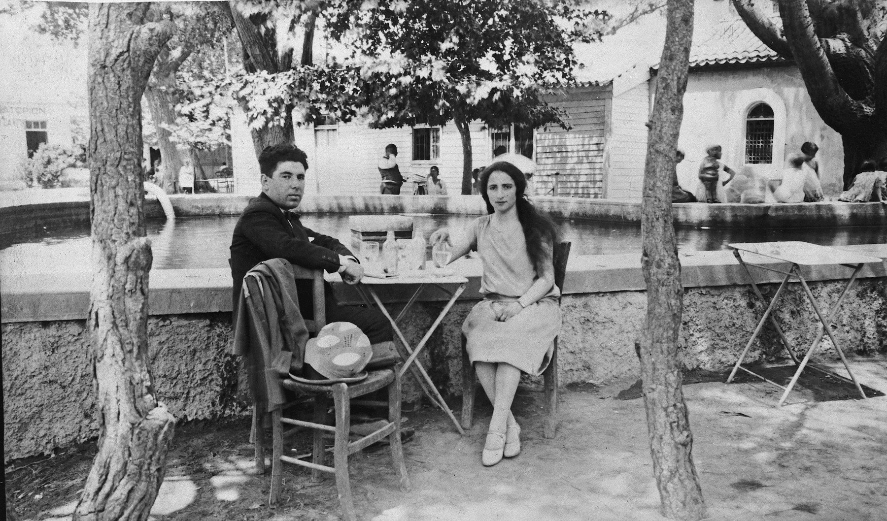 A Greek-Jewish couple sits at an outdoor cafe while on their honeymoon in Athens.  Pictured are Leon and Esther Matsas.