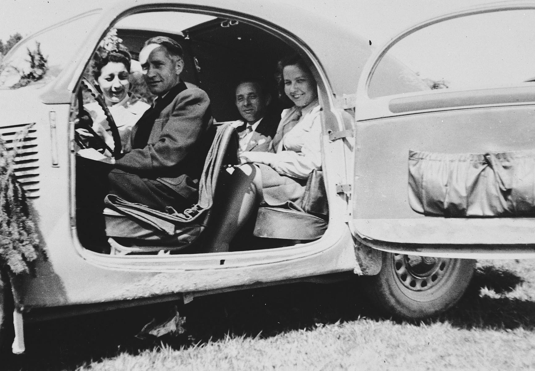 Jewish DPsfrom the Landsberg camp go for an automobile ride.  Among those pictured are Max Freidman (seated in the back seat) and his daughter-in-law Rachel, seated next to him in a white shirt and tie.