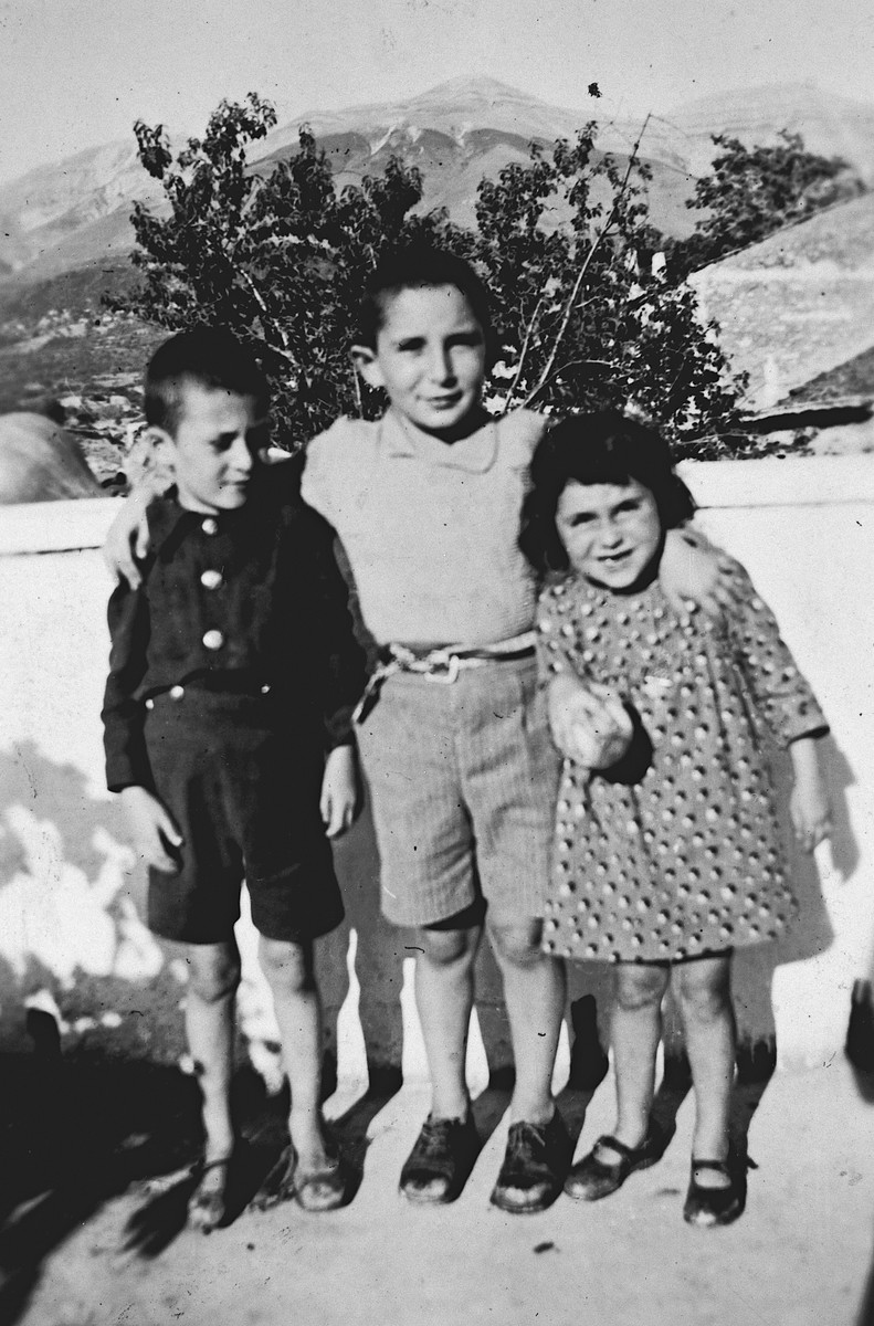 Three young cousins visit their grandparents in Delvine Albania.  Pictured are Pepos, Makis Matsas, and Graciella.