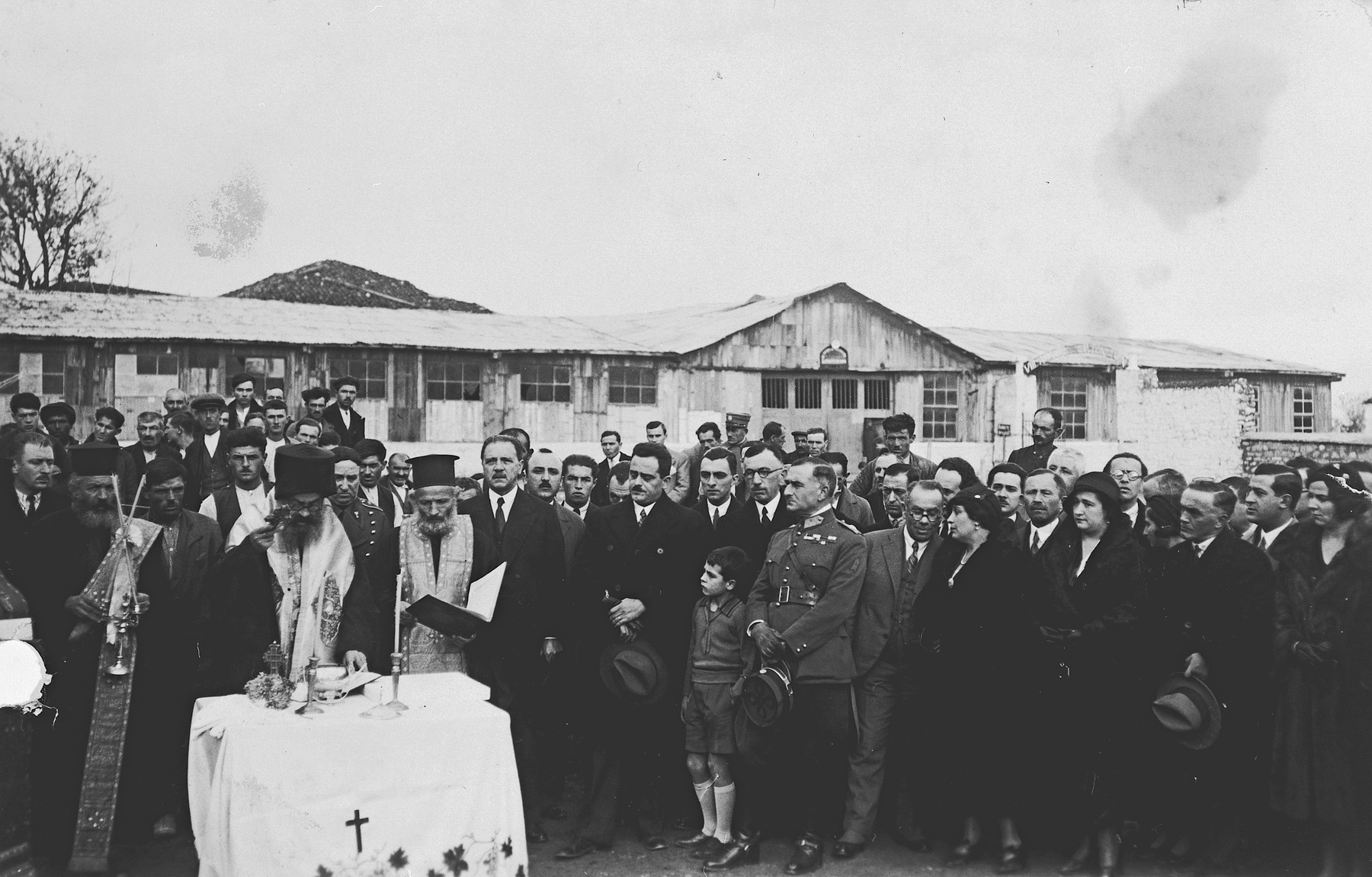 A Greek Orthodox priest presides over the groundbreaking ceremony for the annex of the National Bank of Greece in Ioannina.