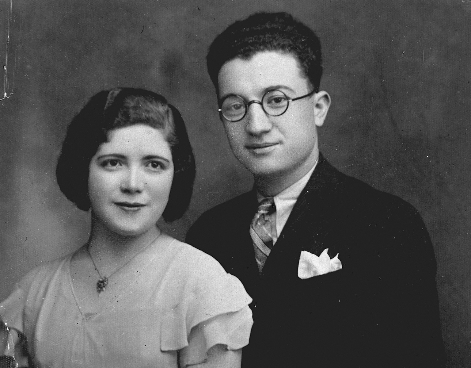 Studio-portrait of a young Greek-Jewish couple in Ioannina.  Pictured are Nissim and Eftyhia Samuel.