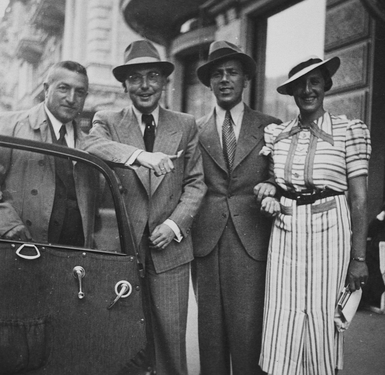 Four friends pose next to an automobile.    Among those pictured are Alfred and Lill Rahn (third and fourth from the left).