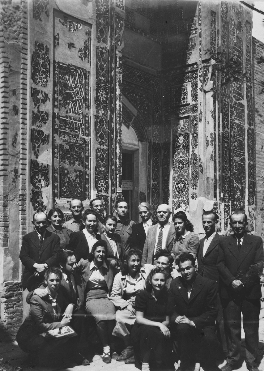 Group portrait of Jewish refugees in Samarkand in front of Tamarlane's tomb.  Among those pictured are the donor Marc Ratner (top row, center) and his mother Gustava Ratner (second row, third from the left).  Also pictured are Hanka Lichtson, Henry Altman, Hanka's parents, Ida and Hala Milikowska , Zosia Weis, and Jakub Bernard (Yakov Dov) Tobias (front row, far right).