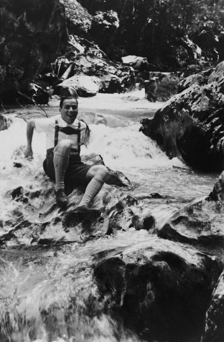 Close-up portrait of a German-Jewish man wearing lederhosen riding the whitewater of a mountain stream.  Pictured is Alfred Rahn.