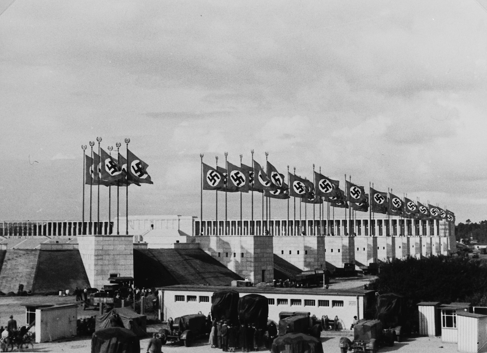 Nazi flags wave above the stadium for the Nuremberg rally.  This photograph was taken by a German Jewish woman, Lilli Rahn, who later emigrated.