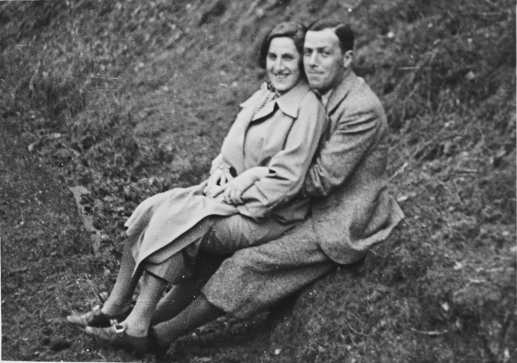 Close-up portrait of a German-Jewish couple sitting on a hillside.  Pictured are Lilli and Alfred Rahn.