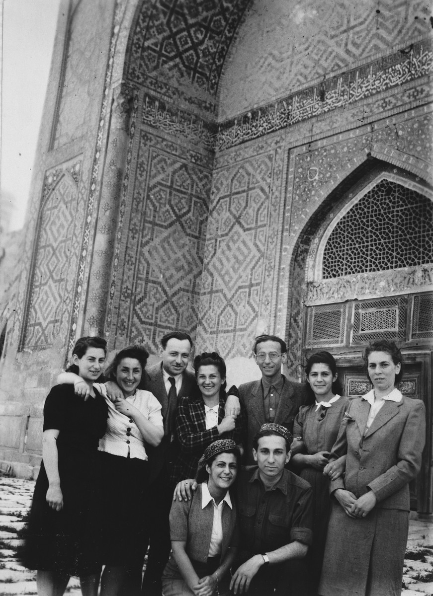 Group portrait of Jewish refugees in Samarkand in front of Tamarlane's tomb.  Seated left to right are Halla Milikowska and Marc Ratner.  Standing left to right are Irka Lichtson, ?, Hewn Stanlsz, Alicja Ratner, ?, Ida Milikowska and Hanka Lichtson.