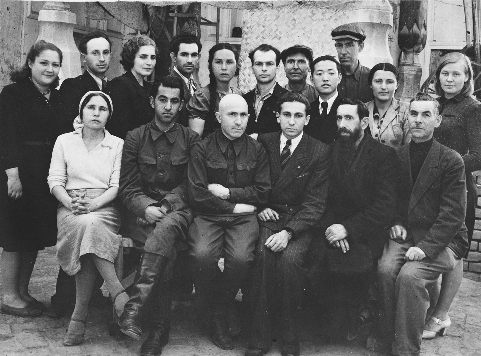 Group portrait of members of a Soviet collective in Samarkand.  Pictured in the center is Marjan Ratner.