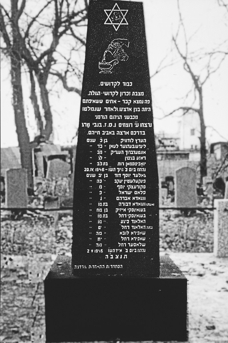 Memorial in the Moiodova Street Cemetery to eighteen Jews who were murdered by Polish nationalists in Nowy Targ in April and May 1945.  Among those killed were Abraham and Devorah Wygoda, the donor's parents.