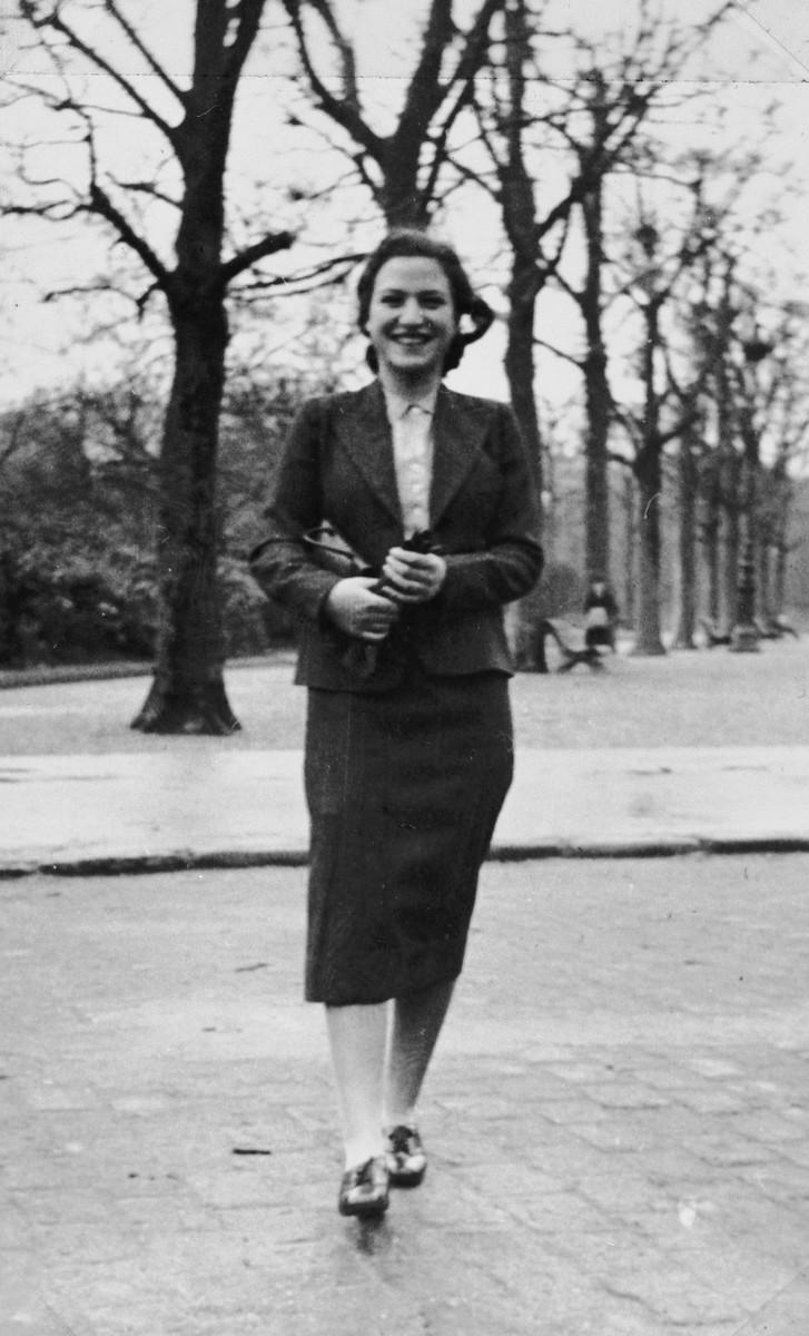 Lore Rothheimer, a German-Jewish refugee, walks down a street in Paris.