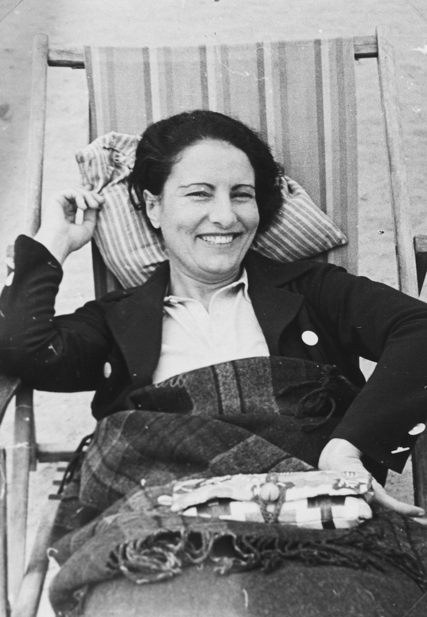 Close-up portrait of a German-Jewish woman relaxing on a deck chair in a vacation spa.  Pictured is Lee Gran who survived the war in Shanghai.