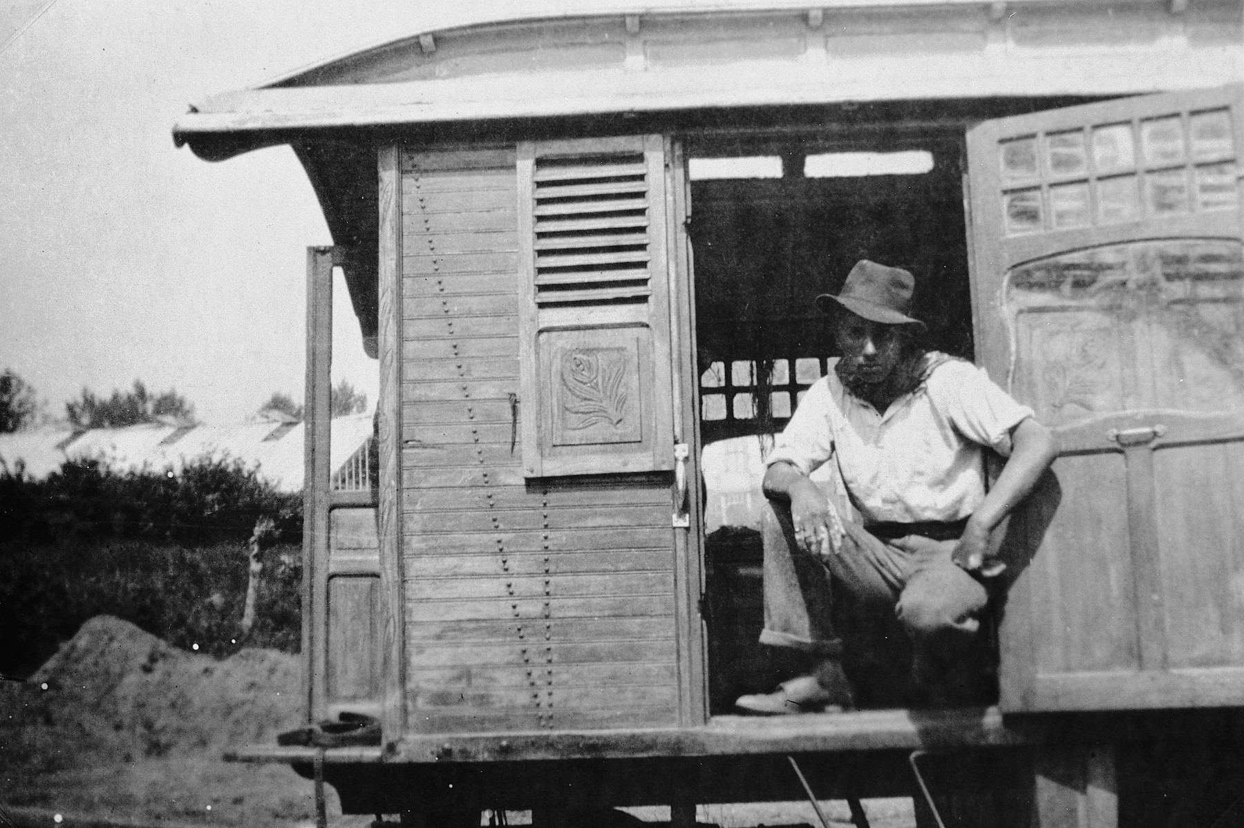 A Roma (Gypsy) man in the doorway of his caravan.