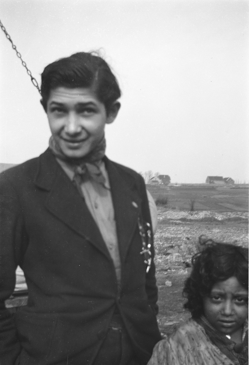A Roma (Gypsy) youth and a child pose for a photograph.