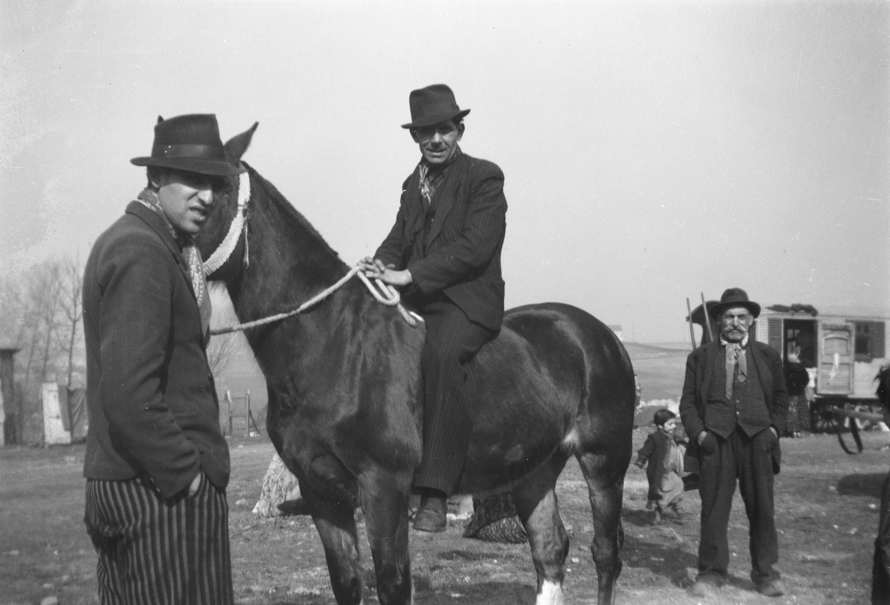 """A Roma (Gyspy) man sits astride a horse as others look on.  The caption in """"The Heroic Present"""" reads, """"Europe, 1930s."""""""