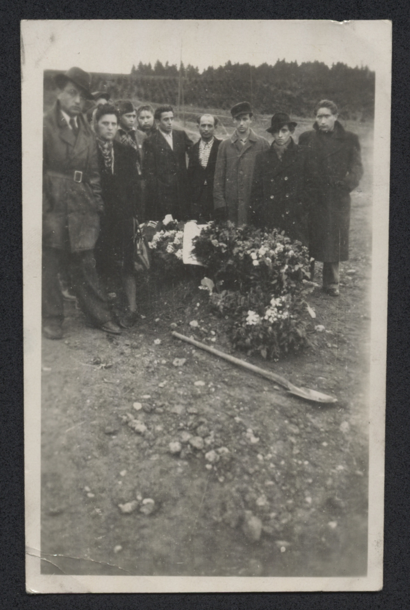 Diaplaced persons lay a wreath at the burial spot of Jewish victims of the Holocaust during a postwar burial ceremony.