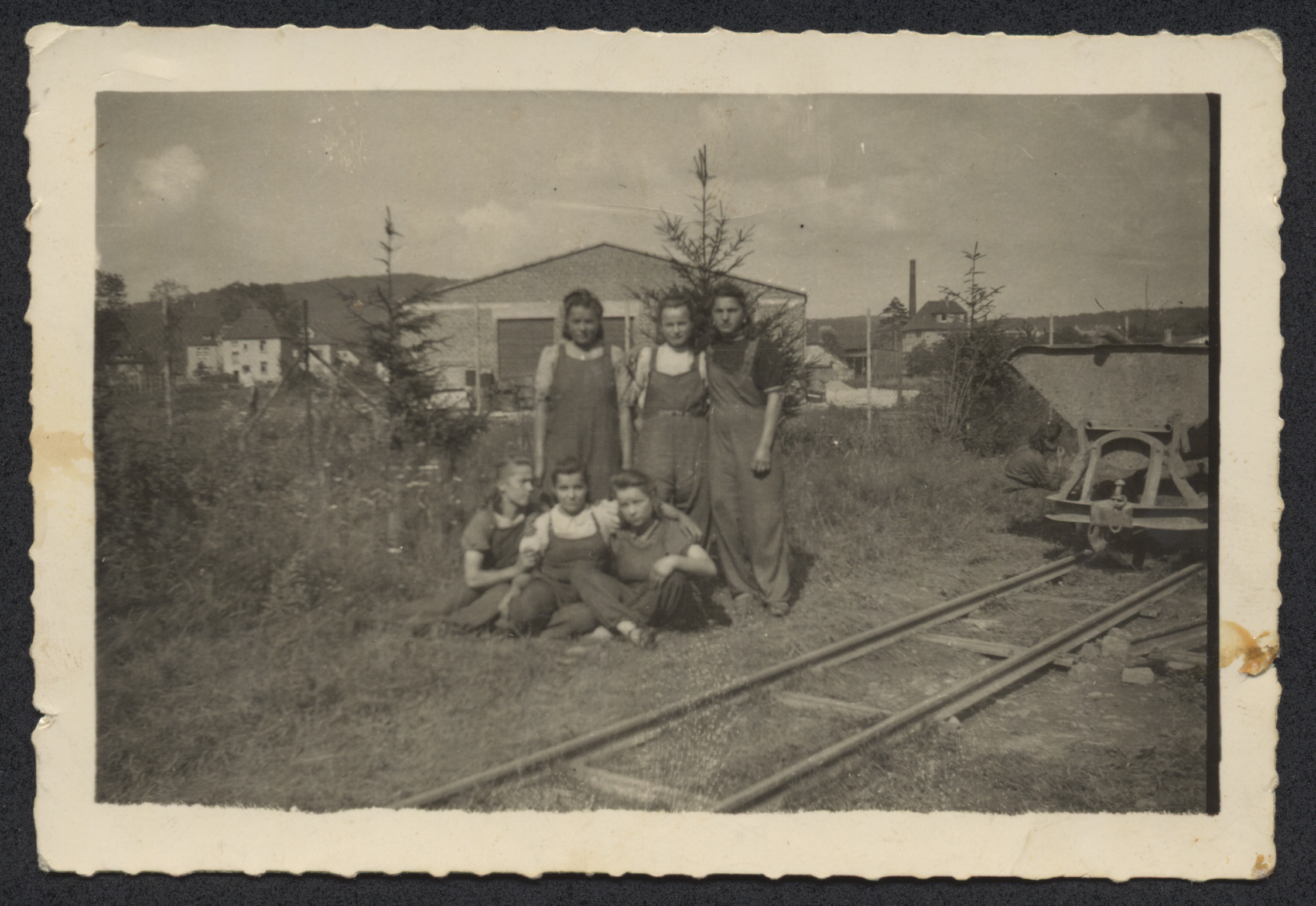 Hencia Wagner (standing right) works in munitions factory while hiding as a Catholic laborer.  Also pictured is her friend Carolina Wilk (middle).