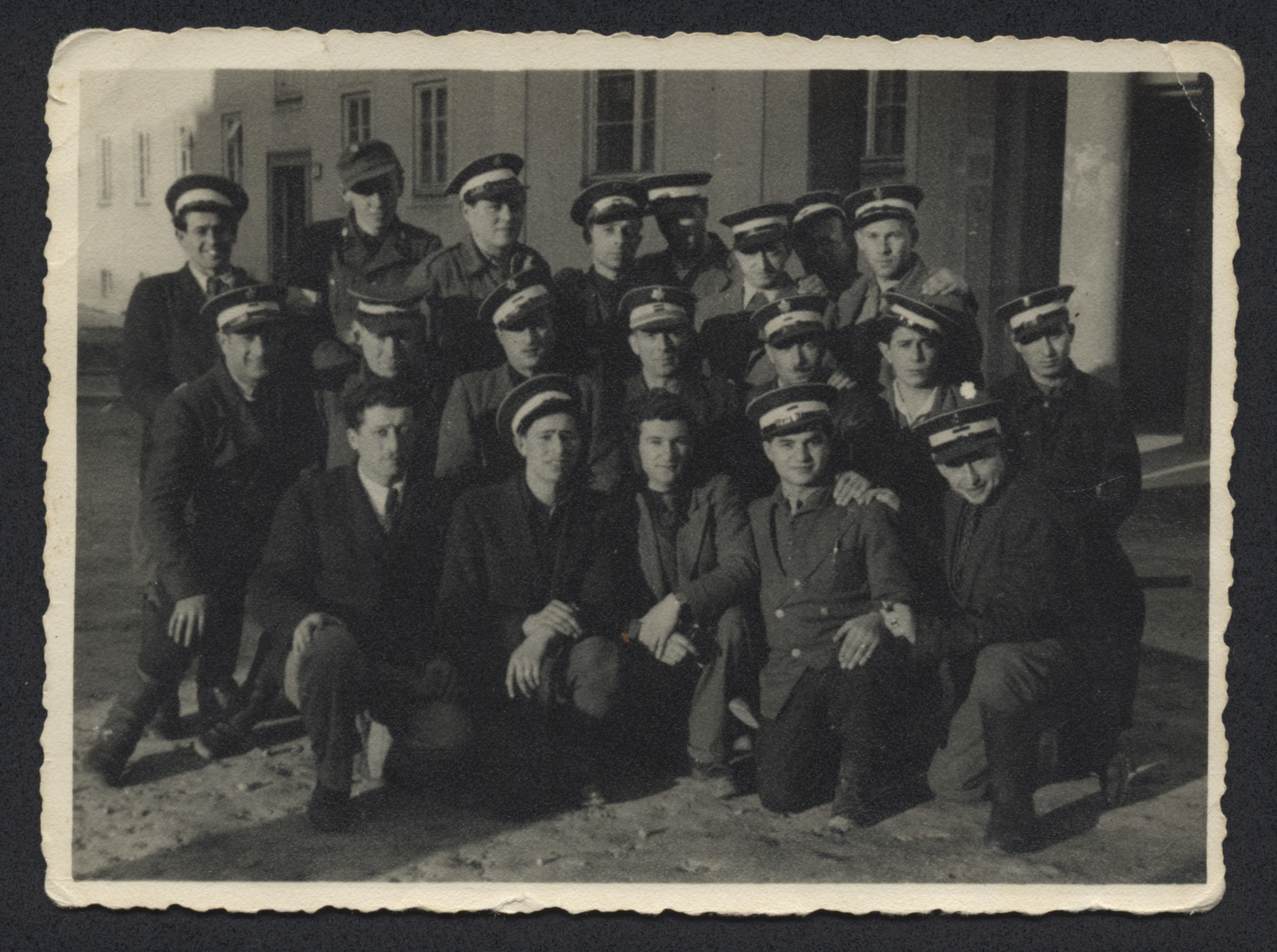 Group portrait of Jewish policemen in the Bindermichl displaced persons camp.  William Abraham is pictured in the first row, second from the right.  His brother-in-law Simon Wizel is in the second row, second in from the right.