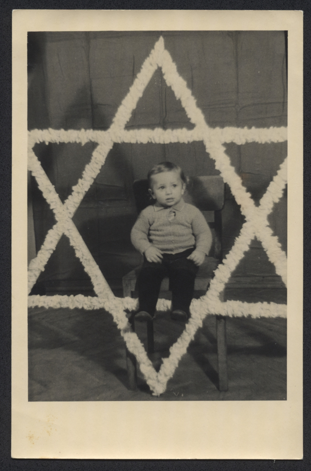 David Greenfield sits in the center of a large Star of David.
