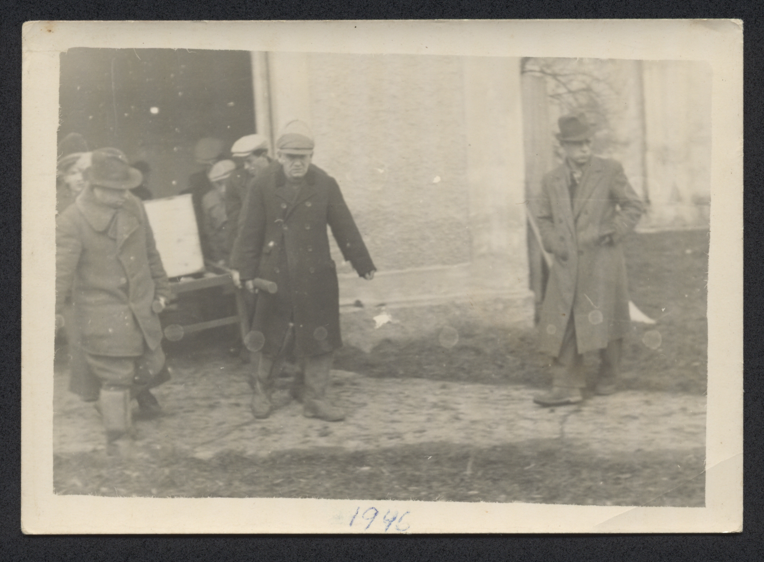 Jewish displaced persons rebury exhumed corpses in Mauthausen one year after the liberation of the camp.