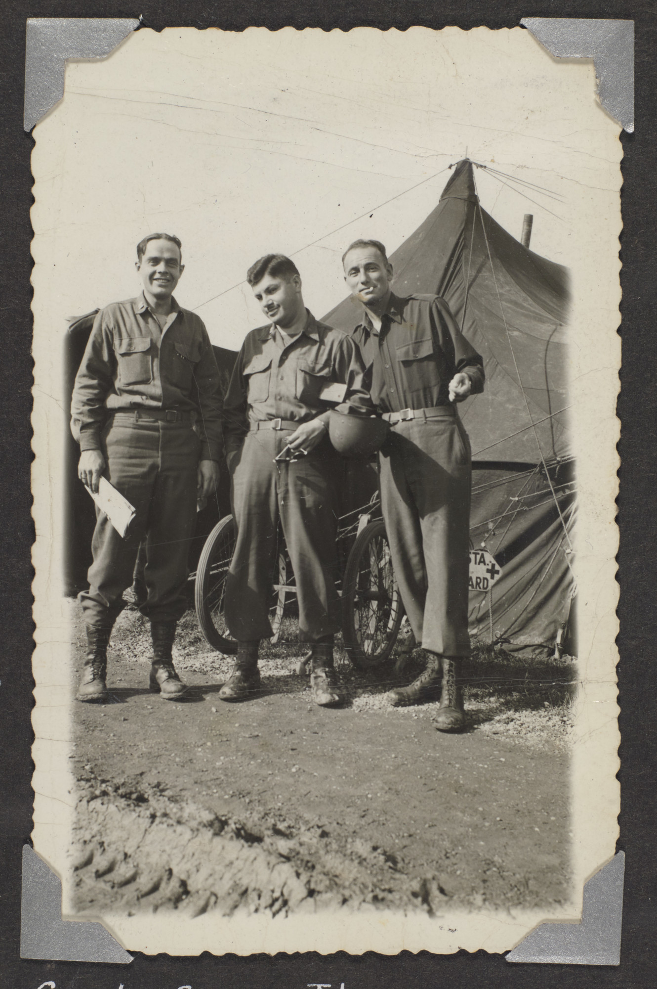 Three American servicemen stand outside a tent.   Pictured are Capt. George Thompson, Louis Bernard Katz, and Capt. Roger Steinhardt.