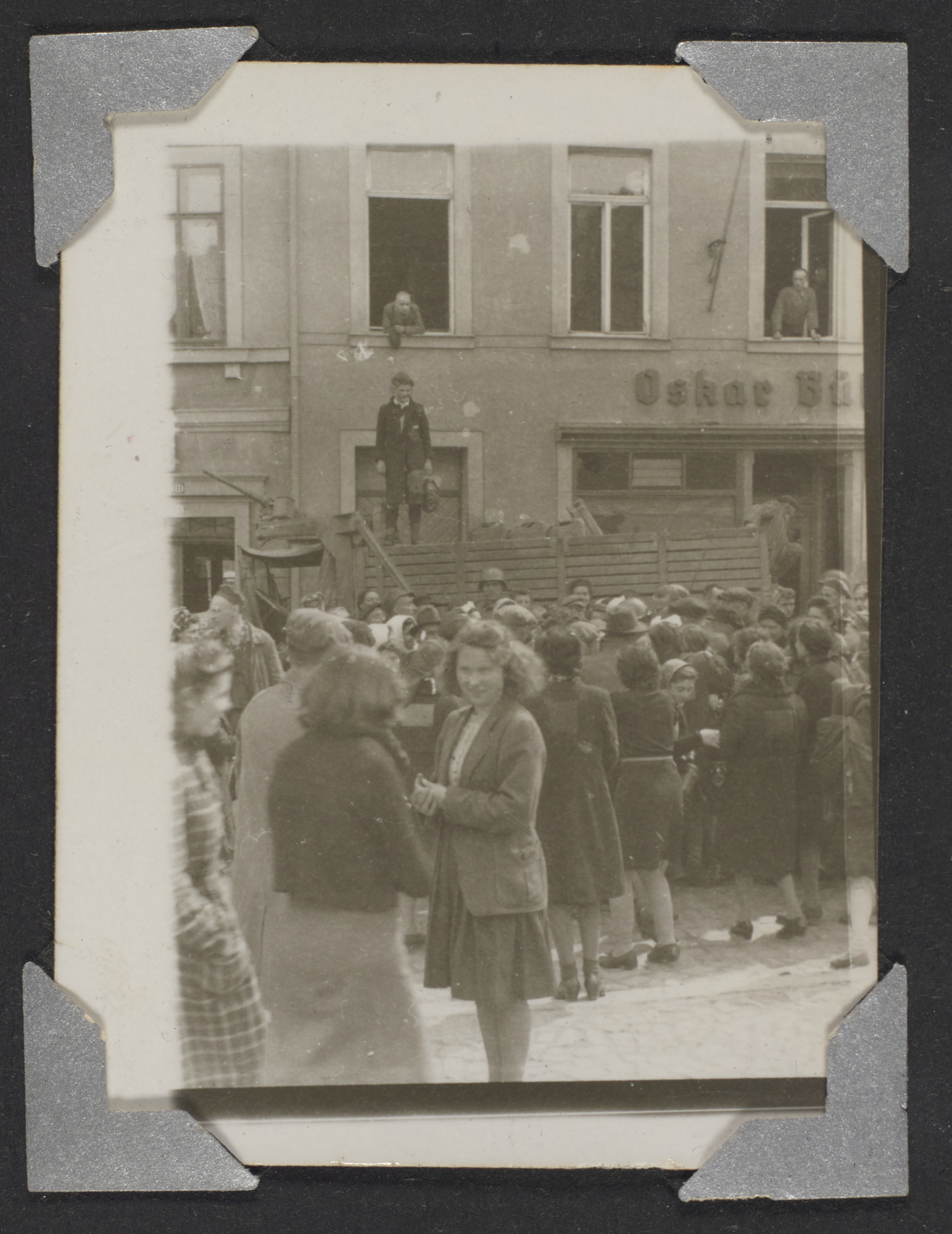 Crowds of Hungarian Jewish refugees gather in the street.