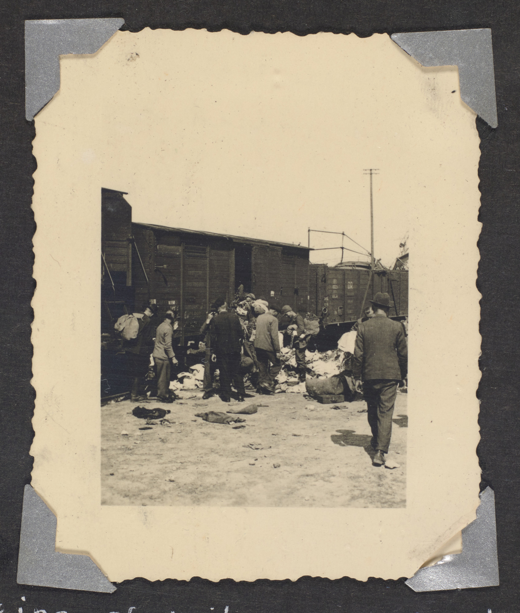Survivors and civilians loot supplies from a railroad yard.  Original caption: Looting of railroad yards by freed refugees--April 1945