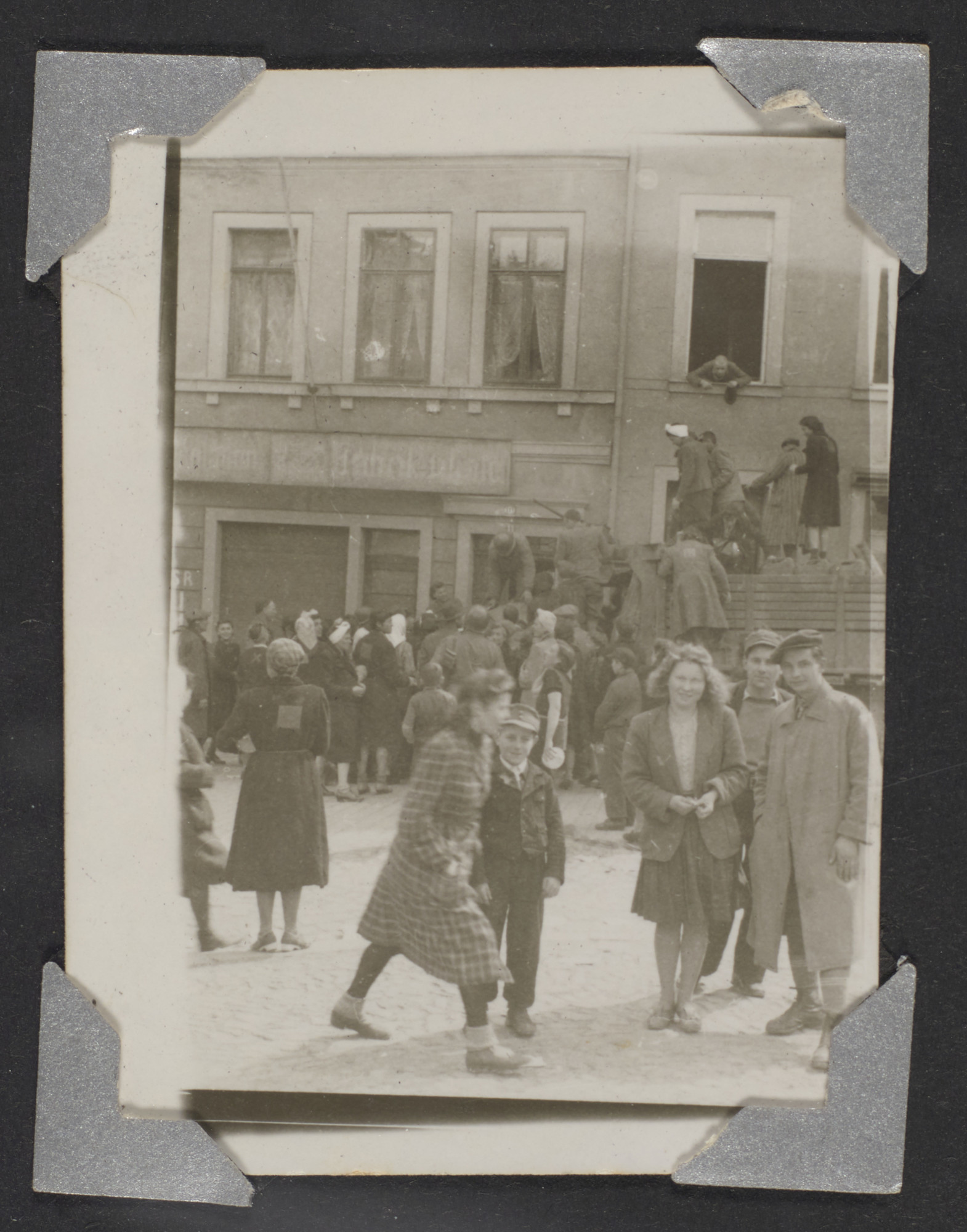 Young Hungarian Jewish refugees gather in the street in Waldenberg.
