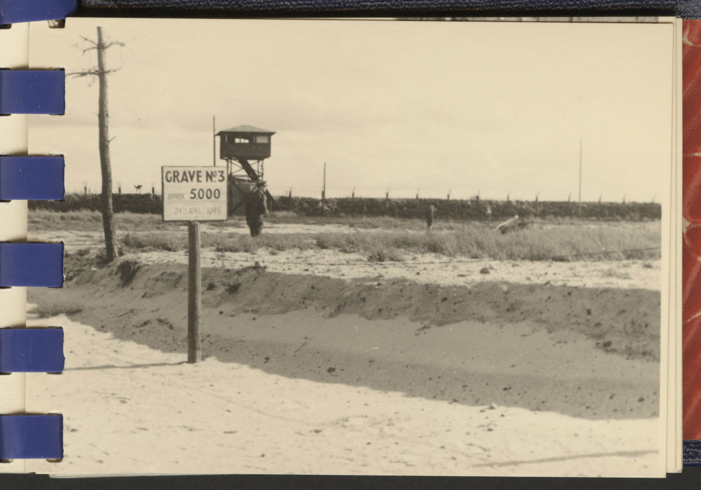 One page from a small photograph booklet containing images of Bergen-Belsen shortly after liberation.  A sign indicates Grave No. 3, where 5000 victims were buried.