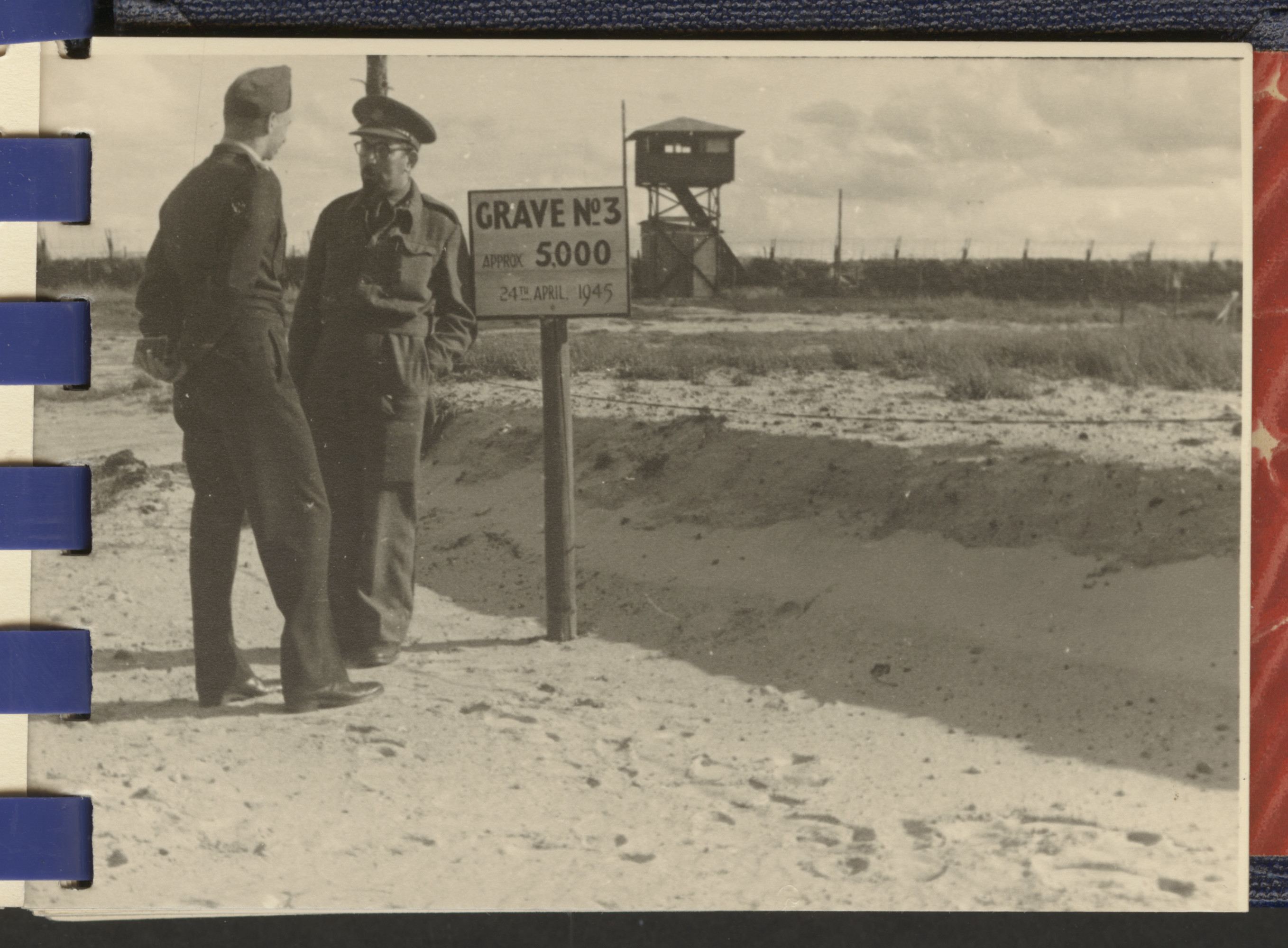 "One page from a small photograph booklet containing images of Bergen-Belsen shortly after liberation.  The inscription on the back reads, ""Capt. Stern [?] talking to British Rabbi near Belsen grave."""