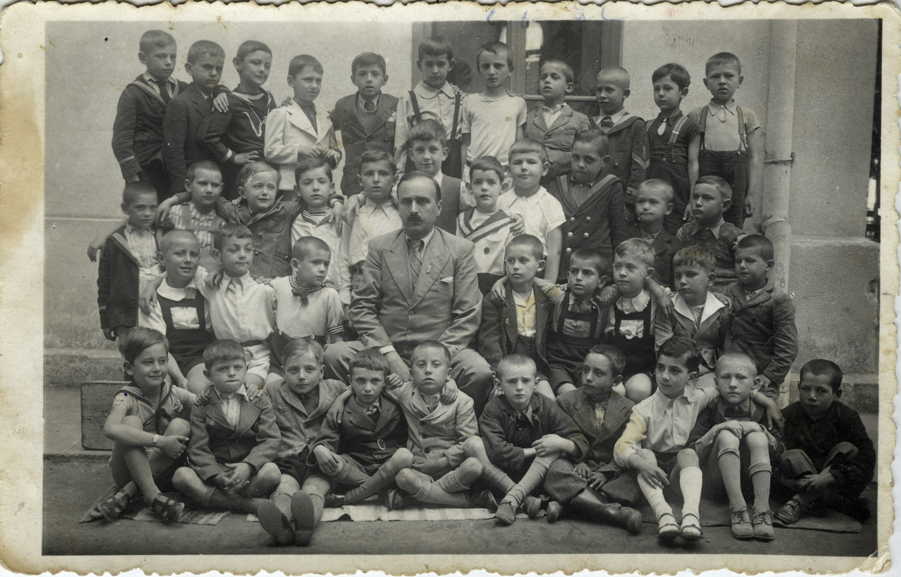 A picture of school children in Belgrade prior to the war.   Joseph (third from the right in the front row) is pictured along with his classmates and teacher who was heroic and would not let Germans know which children were Jewish.