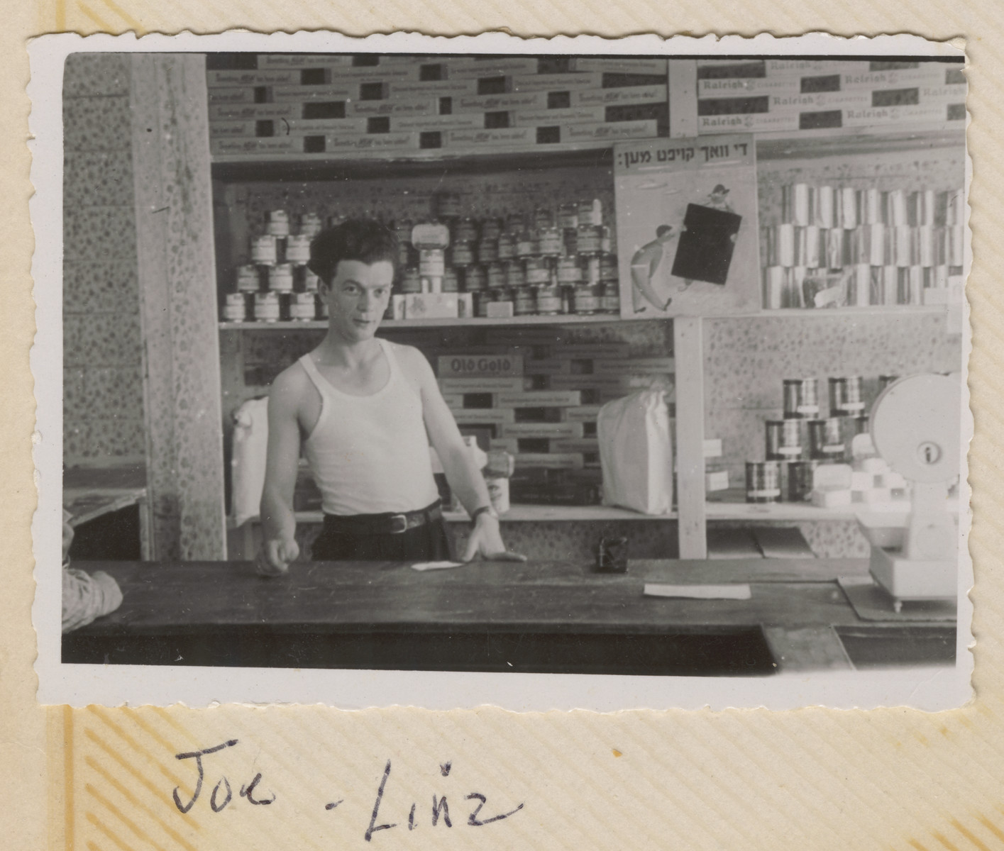 Joseph Pinczuk works in a grocery store in the Wegscheid displaced persons camp in Linz, Austria.